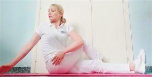 Stretching del muscolo vasto laterale da seduto